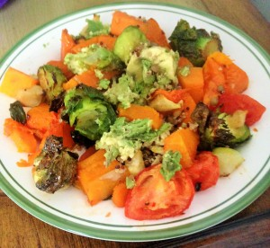 roasted butternut squash with brussels sprouts, plum tomatoes, apples and avocado