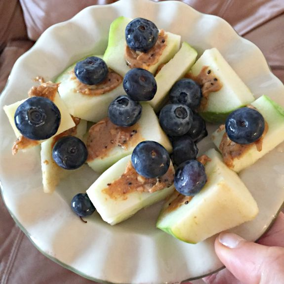 apple with peanut butter and blueberries