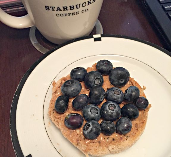english muffin with peanut butter and blueberries